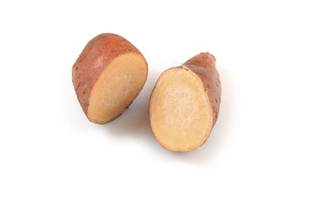 four sweet potatoes, white background