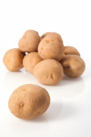 nine potatoes, white background Banco de Imagens