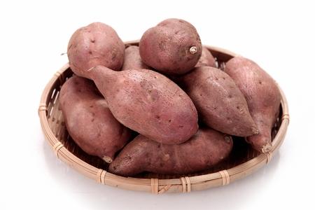 sweet potatoes on woven  basket Banco de Imagens