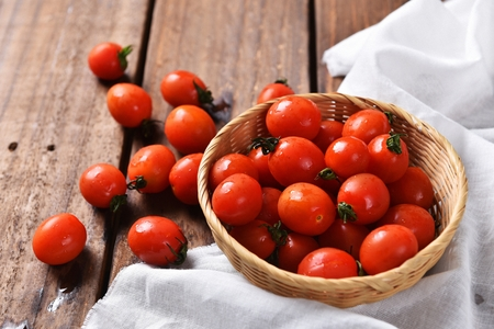 cherry tomatoes in woven basket