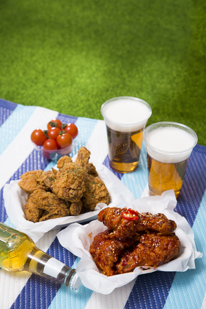 Korean style chicken and beer, delicious fried or spicy sauce chicken with cool beer