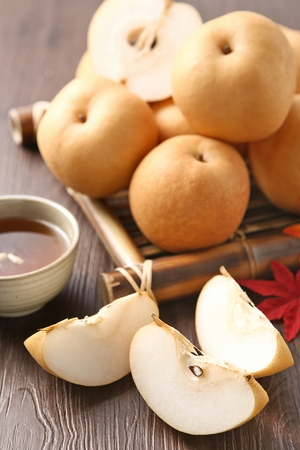 pears on wood tray