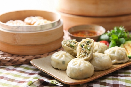 steamed dumplings on rectangular plate, and steamed dumplings in steamer