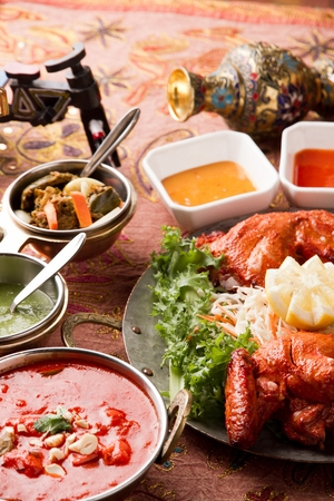indian food such as tandoori chicken and curry platter