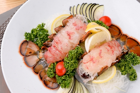 lobster tail on white plate Standard-Bild