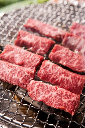 beef chuck flap tail being grilled on pan