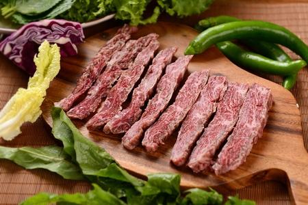raw beef chuck flap tail on chopping board