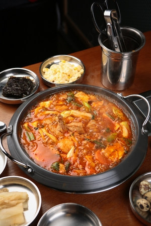 braised spicy chicken with vegetables and dried seaweed, white kimchi Stock Photo