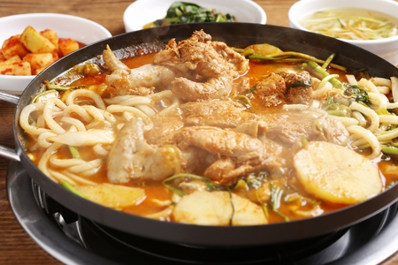 braised spicy chicken with vegetables and noodles