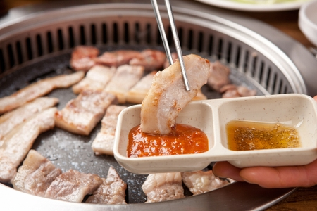 grilled pork dipped in Doenjang, soy bean paste