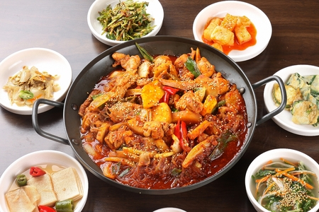 spicy chicken stew with vegetables, with side dishes
