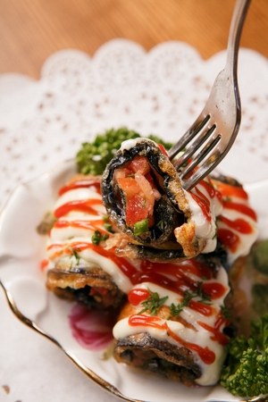 fork grabbing eggplant roll