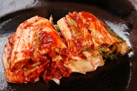 spicy cabbage kimchi on ceramic plate Stock Photo