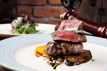 Sliced beef tenderloin steak on plate