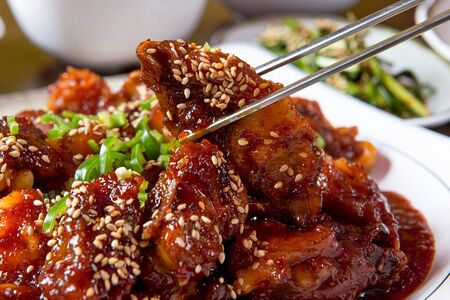 Spicy pig's feet grabbed with chopsticks