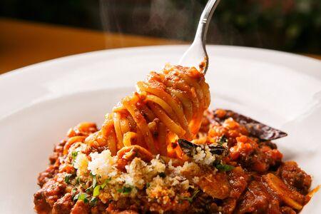 Bolognese spaghetti rolled up with fork Reklamní fotografie
