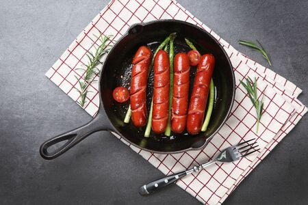 Grilled sausage and vegetables on frying pan 스톡 콘텐츠