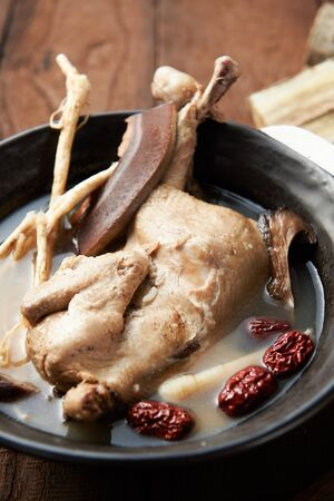 ginseng chicken soup with various medicinal herbs