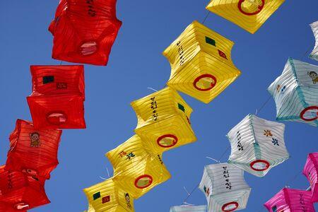 Buddhas Birthday, colorful lanterns against blue sky Imagens