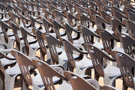 Plastic chairs at outdoors Imagens - 128475780