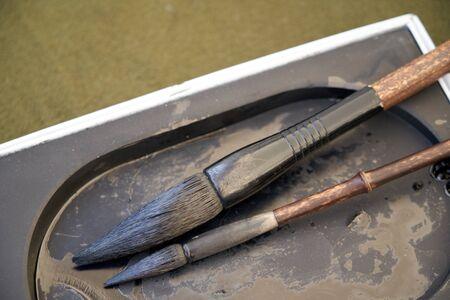 Calligraphic brush and ink stone