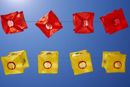 Colorful lanterns against blue sky