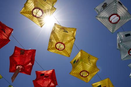 Buddhas Birthday, colorful lanterns against blue sky Editorial