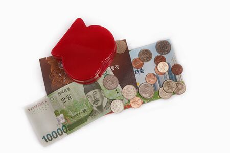 Concept of love and saving money. money box in heart shape with money.