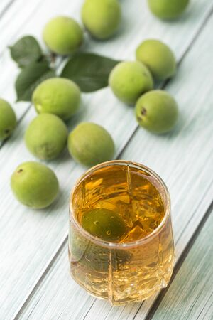 Close up of green plum fruits and drink
