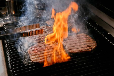 beef being grilled on pan, barbecue Stock Photo