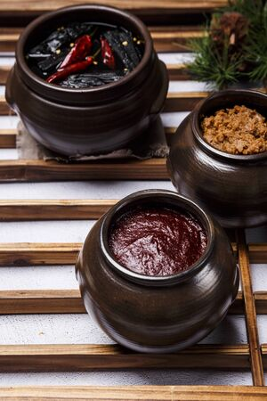 Concept of Korean traditional sauces, soy sauce, soybean paste and red pepper paste