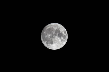 Full moon lightening at black night sky