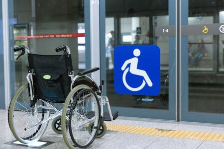 Disabled handicapped man sitting on wheelchair 114 Stock Photo