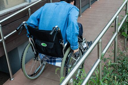 Disabled handicapped man sitting on wheelchair 102 Stock Photo