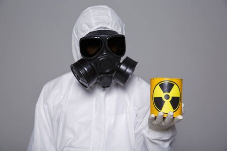 Male scientist in protective suit and antigas mask with glasses. 064