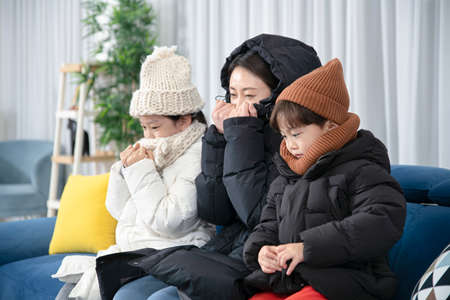 Asian mom and children, sister and brother family concept wearing winter clothes