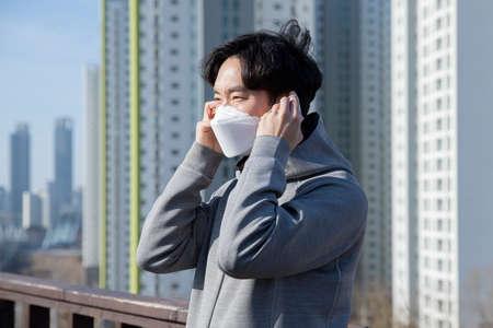 Asian man walking, strolling with mask