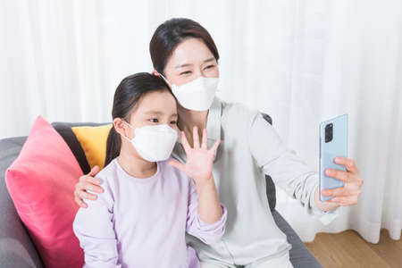 Asian mom and daughter video chat
