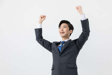 smiling young Asian handsome employee man, achieved, success concept