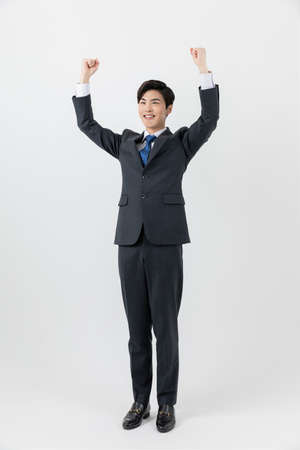 smiling young Asian handsome employee man, achieved, success concept Imagens