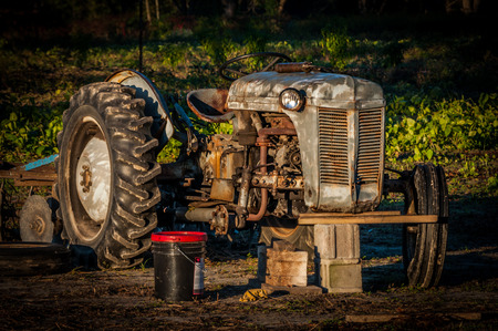 old farm: Old farm tractor in need of repair.