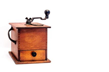 Antique coffee bean grinder on white background.