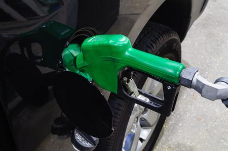 Green Gas Pump Handle Pumping Gas Stock Photo