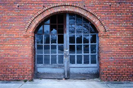 Old Brick Building With Weathered Door Stock Photo