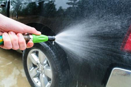 washing car: Green Hose Water Nozzle Washing Car