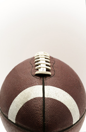 Brown Football and Laces On A White Background Stock Photo