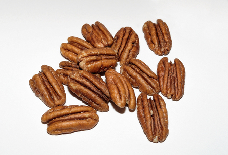 Pile Of Dried Shelled  Pecans On A White Background