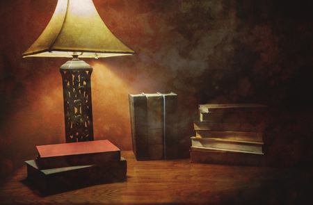 Stack Of Hardcover Books On A Wood Table With Lamp