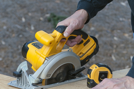 Cordless Circular Saw Cutting Plywood By Hand Stock Photo