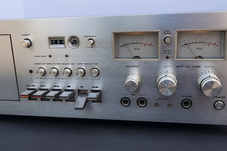 Vintage Stereo Tape Deck Close Up With VU Meters And Controls